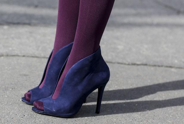 Vestidos mini ficam melhor com sandálias abotinadas ou ankle boots (Foto: Getty Images)